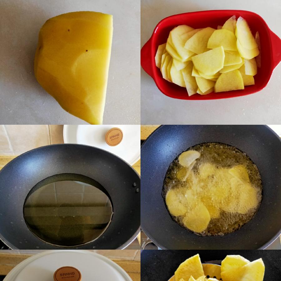 腌制肉片时正好将土豆去皮切片,洗干净淀粉,锅里放入适量油烧热油,下入土豆片炸至变脆,捞出控干油备用。